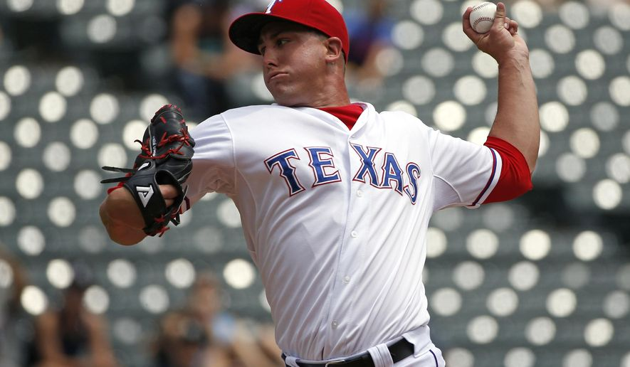 Texas Rangers starting pitcher Derek Holland delivers during the first inning of a baseball game against the Seattle Mariners, Wednesday, Aug. 19, 2015, in Arlington, Texas. (AP Photo/Ron Jenkins)