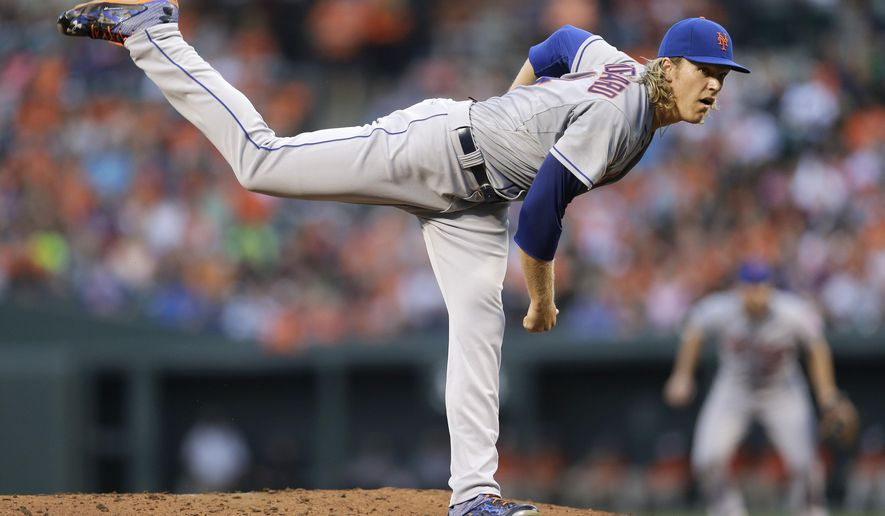 New York Mets starting pitcher Noah Syndergaard follows through on a delivery to the Baltimore Orioles during the first inning of a baseball game, Wednesday, Aug. 19, 2015, in Baltimore. (AP Photo/Patrick Semansky)