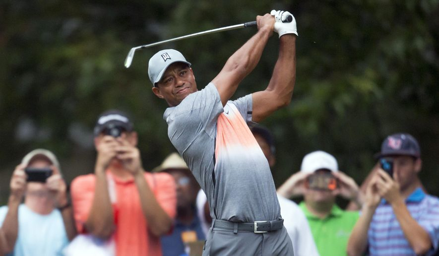 Tiger Woods tees off on the sixth hole during the pro-am at the Wyndham Championship golf tournament, Wednesday, Aug. 19, 2015, at Sedgefield Country Club in Greensboro, N.C. (AP Photo/Rob Brown)