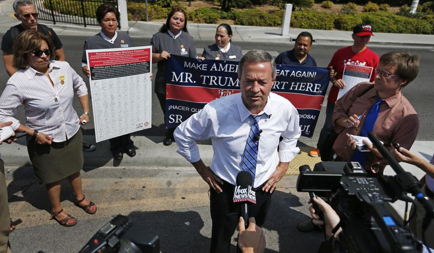Democratic presidential candidate, former Maryland Gov. Martin O'Malley, speaks at a news conference in front of the Trump International hotel, Wednesday, Aug. 19, 2015, in Las Vegas. O'Malley, who is scheduled to speak at the AFL-CIO Constitutional Convention Wednesday in Las Vegas, spoke in front of the hotel to highlight employee's attempts to unionize. (AP Photo/John Locher)