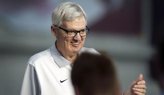 Head Coach Frank Beamer smiles as he meets with members of the media as the Virginia Tech college football team held its annual pre-season media and fan appreciation day in Blacksburg, Va., on Saturday, Aug. 15, 2015. Virginia Tech is scheduled to play defending national champion Ohio State in the first game of the season Monday, Sept. 7. (Matt Gentry/The Roanoke Times via AP)