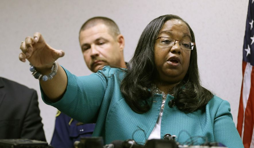 "Wayne Country Proecutor Kym Worthy addresses the media, Wednesday, Aug. 19, 2015 in Detroit. A U.S. customs agent will not be charged in the fatal shooting of a 20-year-old Detroit man, Worthy announced Wednesday. Evidence and witness statements showed Immigration and Customs Enforcement agent Mitchell Quinn was ""justified by the laws of self-defense"" in the April 27 shooting death of Terrance Kellom, Worthy said. ""Yes, black lives matter,"" Worthy said. ""Of course they matter. But you know what else matters? Credible facts matter. ... Doing justice matters and the truth matters."" (AP Photo/Carlos Osorio)"