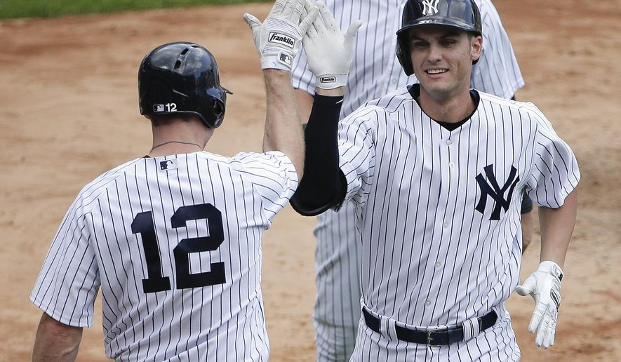 New York Yankees' Greg Bird, right, is greeted by Chase Headley (12) after hitting a two-run home run against the Minnesota Twins during the sixth inning of a baseball game, Wednesday, Aug. 19, 2015, in New York. It was his second two-run home run of the game and second career major league home run. (AP Photo/Julie Jacobson)