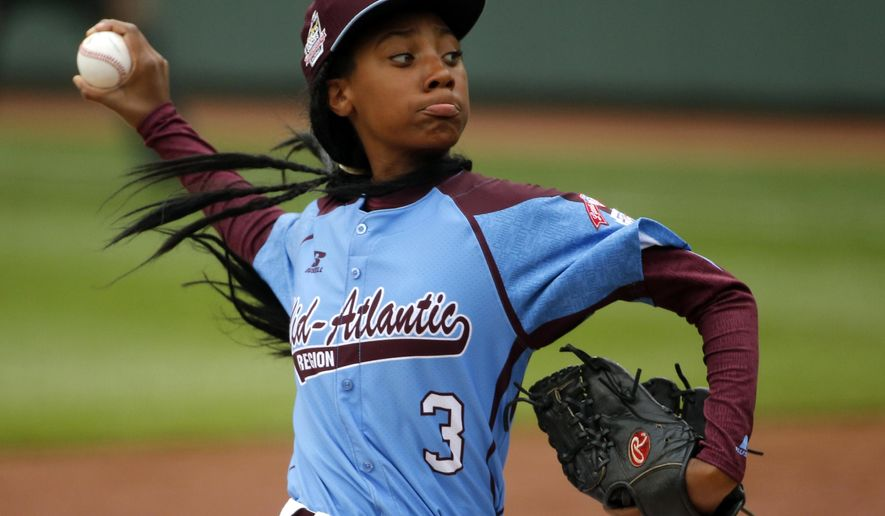 FILE - In this Aug. 15, 2014, file photo, Pennsylvania's  Mo'ne Davis delivers in the fifth inning against Tennessee during a baseball game at the Little League World Series tournament in South Williamsport, Pa. Davis was the talk of the sports world and beyond after becoming the first female to win a game in the Little League World Series. Her success has inspired other girls to pursue baseball, though no girls will be playing for the championship at Williamsport when the 16-team tournament starts Thursday. (AP Photo/Gene J. Puskar, File)