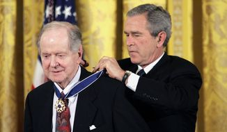 In this Nov. 9, 2005, photo, President George W. Bush presents the Presidential Medal of Freedom to historian Robert Conquest, left, in Washington. Conquest, whose influential works on Soviet history shed light on the terror during the Stalin era, has died. Conquest's wife, Elizabeth Neece, said he died Monday, Aug. 3, 2015. He was 98. (AP Photo/Evan Vucci, File)