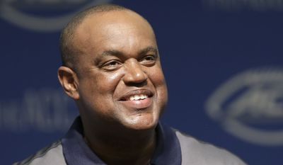 Virginia coach Mike London smiles as he responds to questions during the ACC NCAA college football kickoff in Pinehurst, N.C., Tuesday, July 21, 2015. (AP Photo/Gerry Broome)