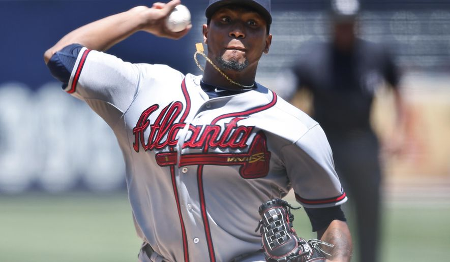 Atlanta Braves starting pitcher Julio Teheran throws against the San Diego Padres during the first inning of a baseball game Wednesday, Aug. 19, 2015, in San Diego. (AP Photo/Lenny Ignelzi)