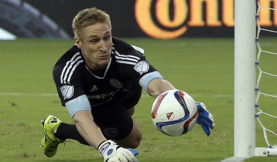 Sporting Kansas City goalkeeper Tim Melia makes a save against the San Jose Earthquakes during the first half of an MLS soccer match in Kansas City, Kan., Wednesday, Aug. 19, 2015. (AP Photo/Orlin Wagner)