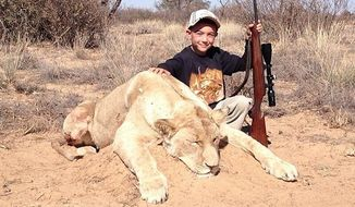 "Allen Tarpley, of Crown Point, Indiana, has deleted his Twitter account after being widely criticized for a years-old photo he posted showing his 7-year-old son after hunting ""his first lion."" (@Safarihunter77 via Daily Mail)"