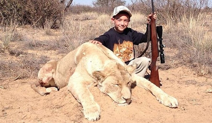 """Allen Tarpley, of Crown Point, Indiana, has deleted his Twitter account after being widely criticized for a years-old photo he posted showing his 7-year-old son after hunting """"his first lion."""" (@Safarihunter77 via Daily Mail)"""