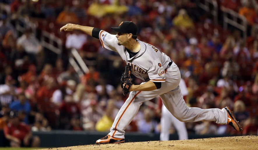 San Francisco Giants starting pitcher Ryan Vogelsong throws during the first inning of a baseball game against the St. Louis Cardinals, Tuesday, Aug. 18, 2015, in St. Louis. (AP Photo/Jeff Roberson)