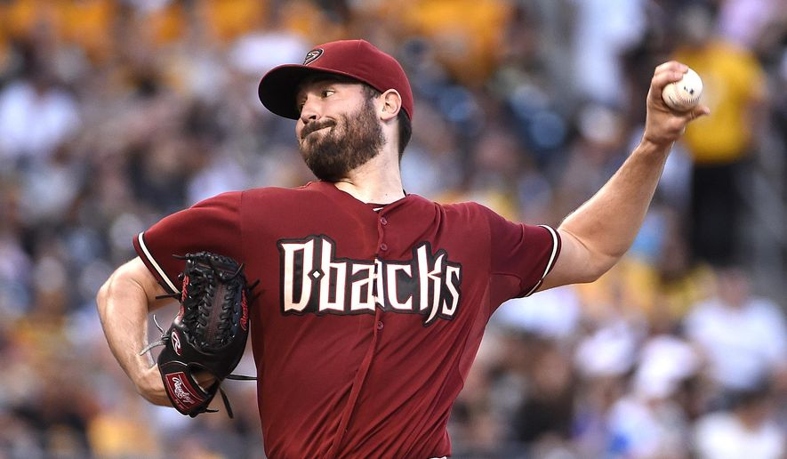Arizona Diamondbacks pitcher Robbie Ray throws during the first inning of a baseball game against the Pittsburgh Pirates, Wednesday, Aug. 19, 2015, in Pittsburgh.  (AP Photo/Fred Vuich)