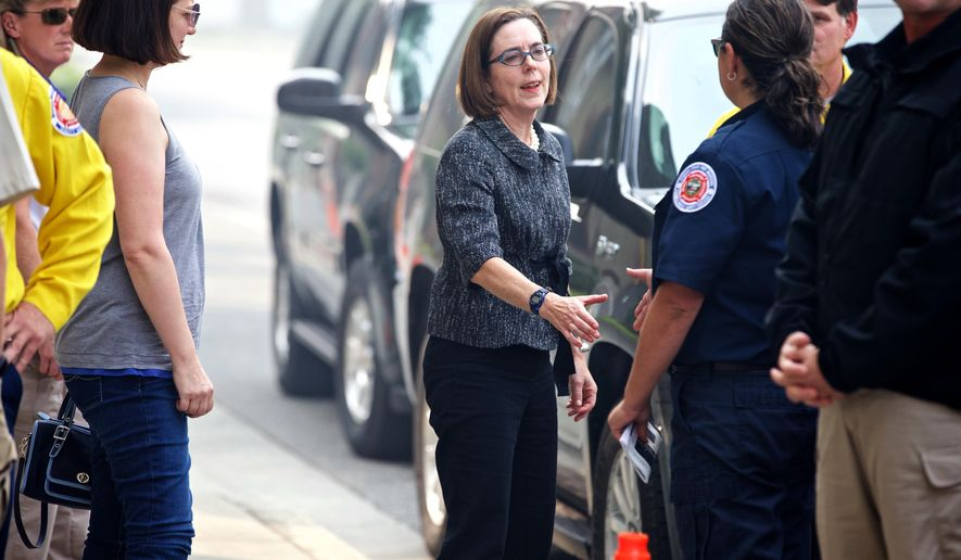 Gov. Kate Brown meets with homeowners in Canyon City, Ore., who lost their homes to the Canyon Creek Complex fire, Wednesday, Aug. 19, 2015, near John Day, Ore. (Thomas Boyd /The Oregonian via AP) MAGS OUT; TV OUT; NO LOCAL INTERNET; THE MERCURY OUT; WILLAMETTE WEEK OUT; PAMPLIN MEDIA GROUP OUT; MANDATORY CREDIT