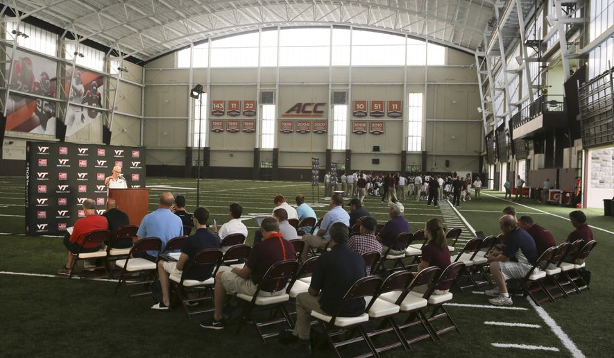 Virginia Tech head coach Frank Beamer holds a news conference inside the schools new indoor practice facility dubbed the Beamer Barn as the Virginia Tech college football team held its annual pre-season media and fan appreciation day in Blacksburg, Va., on Saturday, Aug. 15, 2015. Virginia Tech is scheduled to play defending national champion Ohio State in the first game of the season Monday, Sept. 7. (Matt Gentry/The Roanoke Times via AP)