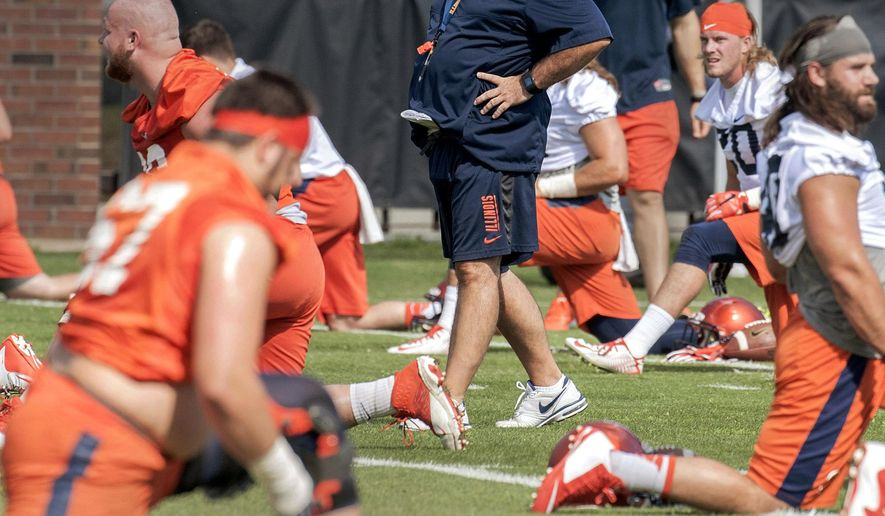 FILE - In this Aug. 6, 2015, file photo, Illinois head coach Tim Beckman watches his team during NCAA college football practice in Champaign, Ill. Illinois hosts Kent State in their season opener on Sept. 4, 2015.  (Rick Danzl/The News-Gazette via AP, File)  MANDATORY CREDIT