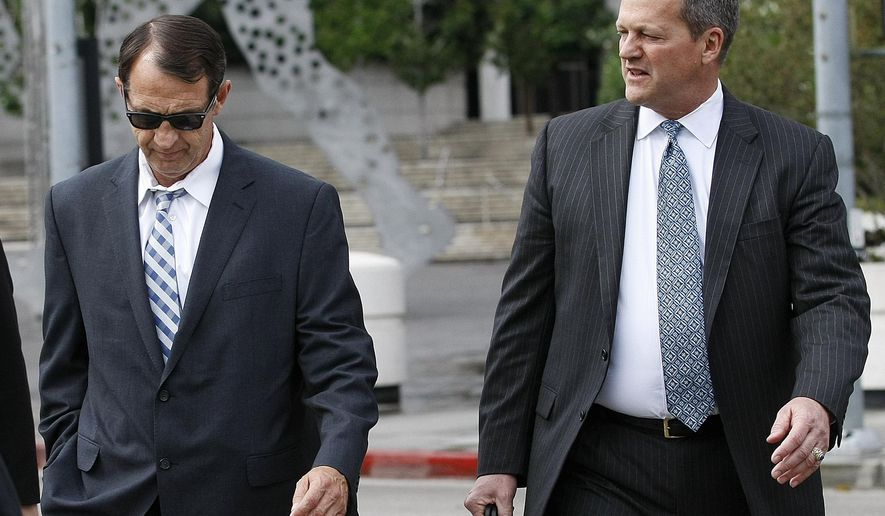 In this May 14, 2015 photo, Tom Carey, left, a former captain in the internal investigations bureau of the Los Angeles County Sheriff's Department, and his attorney leave the federal courthouse on Temple Street in downtown Los Angeles after appearing for an arraignment. The former captain with the nation's largest sheriff's department pleaded guilty Wednesday, Aug. 19, to lying on the witness stand during a widespread misconduct investigation into abuse within the Los Angeles County jail system. (Mel Melcon/Los Angeles Times via AP) NO FORNS; NO SALES; MAGS OUT; ORANGE COUNTY REGISTER OUT; LOS ANGELES DAILY NEWS OUT; INLAND VALLEY DAILY BULLETIN OUT; MANDATORY CREDIT, TV OUT