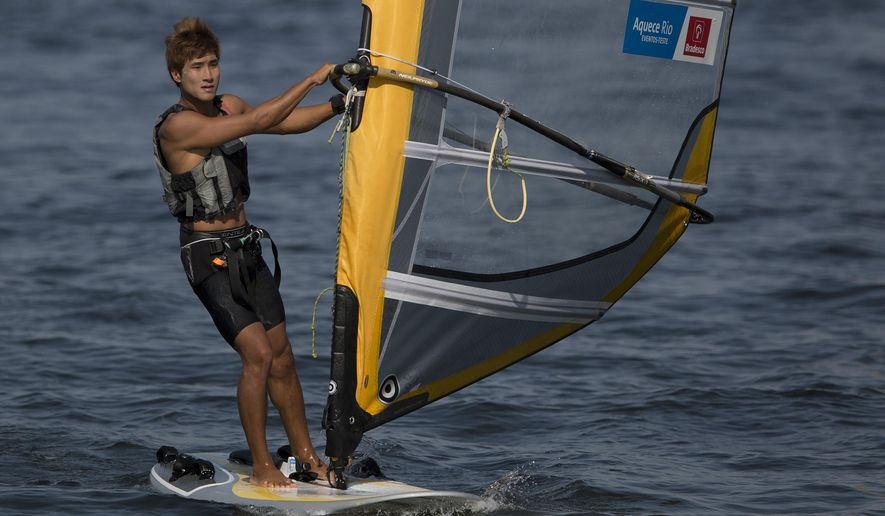 "South Korean Wonwoo Cho sails inshore after competing in the men's RS:X Windsurfer sailing test event, in Guanabara Bay, Rio de Janeiro, Brazil, Wednesday, Aug. 19, 2015.  Wonwoo Cho is one of four athletes to have ""officially"" fallen ill during the Olympic sailing test event. The 20-year-old said Wednesday he was back to ""50-60 percent"" strength and out racing 24 hours after his hospital visit for dehydration, vomiting, headache and dizziness. (AP Photo/Leo Correa)"