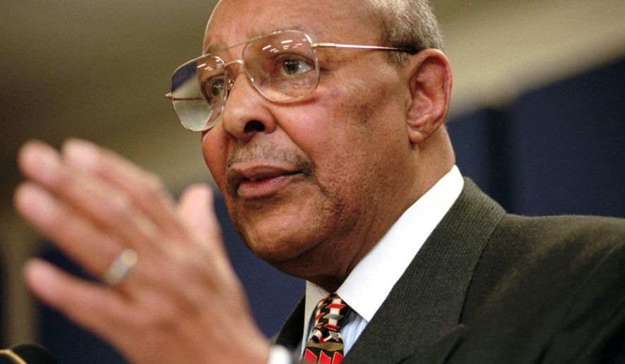 FILE - In this Saturday, Jan. 17, 1998, file photo, Rep. Louis Stokes, D-Ohio, announces, at the Carl B. Stokes Social Services Mall in Cleveland, that he will retire from Congress at the end of the year. Stokes, a 15-term Ohio congressman who took on tough assignments looking into assassinations and scandals, died late Tuesday, Aug. 18, 2015. Stokes was 90. (AP Photo/Tony Dejak, File)