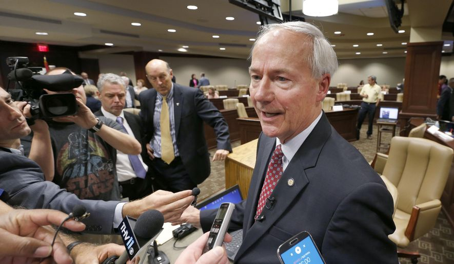 Arkansas Gov. Asa Hutchinson speaks to reporters after addressing a meeting of the Health Reform Legislative Task Force at the Arkansas state Capitol in Little Rock, Ark., Wednesday, Aug. 19, 2015. (AP Photo/Danny Johnston)