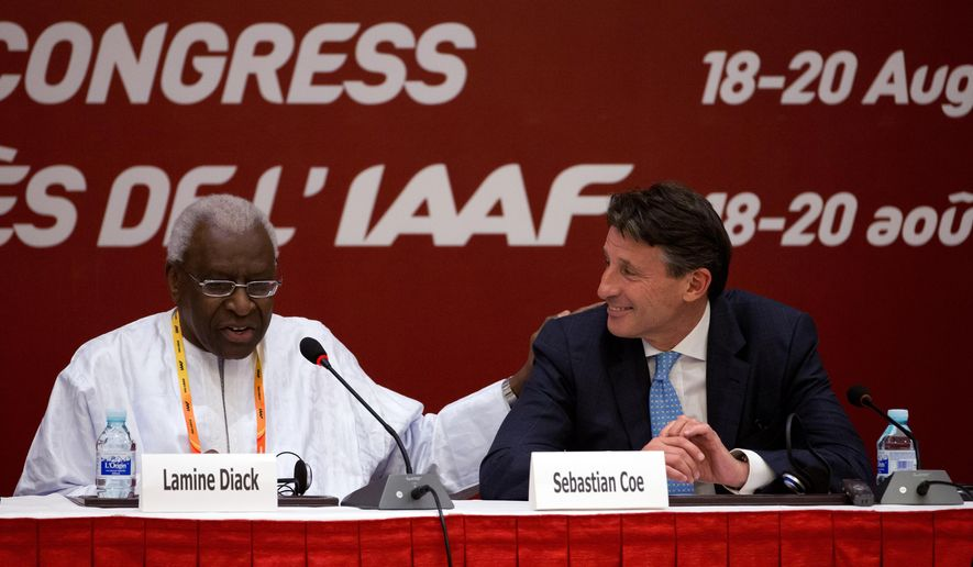 International Association of Athletics Federations outgoing president Lamine Diack, left, speaks next to newly elected president Sebastian Coe during a press briefing at the IAAF Congress at the National Convention Center in Beijing, Wednesday, Aug. 19, 2015. (AP Photo/Andy Wong)