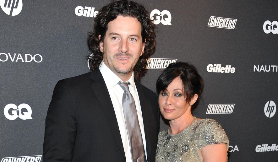 "FILE - In this Oct. 27, 2010 file photo, actress Shannen Doherty, right, and Kurt Iswarienko attend 'The Gentleman's Ball' hosted by GQ Magazine at the Edison Ballroom in New York. Doherty and husband Iswarienko sued her former accountants and business managers on Wednesday, Aug. 19, 2015, accusing them of mismanaging her money and causing the cancellation of her health insurance in 2014. The ""Beverly Hills 90210"" star's lawsuit states Doherty was recently diagnosed with breast cancer and her doctors have told her it worsened during the period when her health insurance had lapsed. (AP Photo/Evan Agostini, File)"