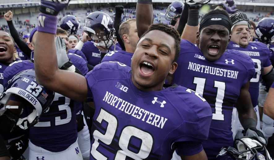 FILE - In this Oct. 4, 2014, file photo, Northwestern running back Justin Jackson (28) celebrates after they defeated Wisconsin 20-14 in an NCAA college football game in Evanston, Ill. Jackson made quite an impression as a freshman, rushing for 1,187 yards and 10 touchdowns. He recorded six 100-yard games and joined Tyrell Sutton in 2005 as the only freshmen to rush for 1,000 yards. Northwestern hosts Stanford on Sept. 5, 2015, to open their season. (AP Photo/Nam Y. Huh, File)