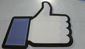 "Facebook's ""like"" symbol is posted at the entrance to the company's campus in Menlo Park, California, in this June 11, 2014, photo. (AP Photo/Jeff Chiu) ** FILE **"