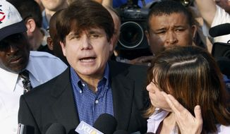 In this March 14, 2012 file photo, former Illinois Gov. Rod Blagojevich speaks to the media outside his home in Chicago as his wife, Patti, wipes away tears a day before he was to report to a prison in Littleton, Colo. On Wednesday, Aug. 19, 2015, the 7th U.S. Circuit Court of Appeals in Chicago posted a notice indicating there would be no rehearing for the imprisoned Democrat on his corruption convictions. (AP Photo/M. Spencer Green, File)