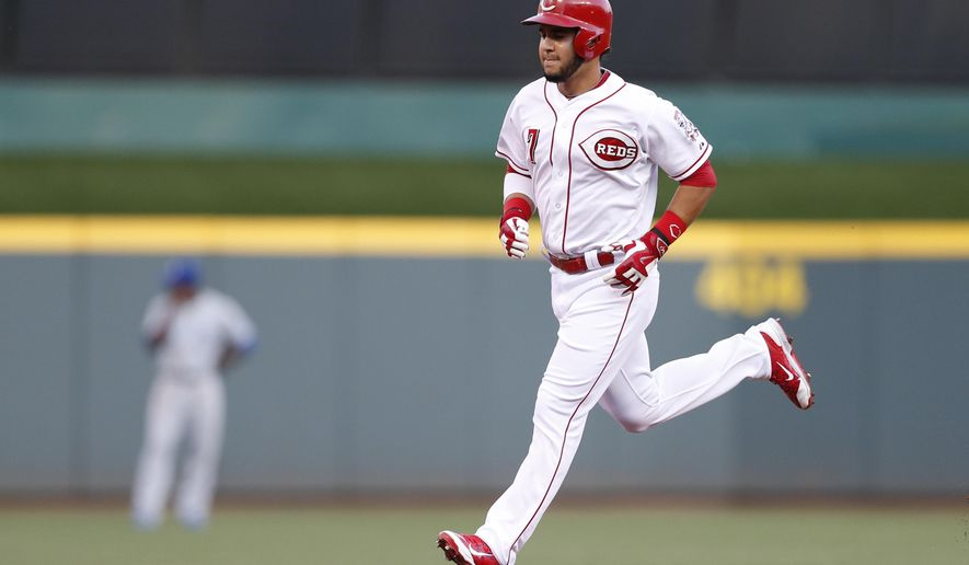 Cincinnati Reds shortstop Eugenio Suarez (7) rounds the bases with a solo home run off Kansas City Royals starting pitcher Edinson Volquez during the first inning of a baseball game, Tuesday, Aug. 18, 2015, in Cincinnati. (AP Photo/Gary Landers)