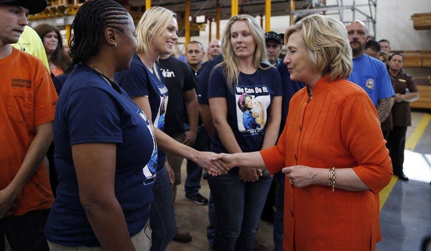 Democratic presidential candidate Hillary Rodham Clinton shakes hands while touring the Carpenters International Training Center in Las Vegas on Aug. 18, 2015. The training center was one of several places Clinton visited in the Las Vegas area on Tuesday. (Associated Press)