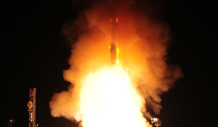 In this photo provided by the U.S. Air Force, an unarmed Minuteman 3 missile launches on Wednesday, Aug. 19, 2015, at Vandenberg Air Force Base, Calif. The Air Force said the missile was launched from California in a test of the intercontinental ballistic missile system. (Joe Davila/U.S. Air Force via AP)