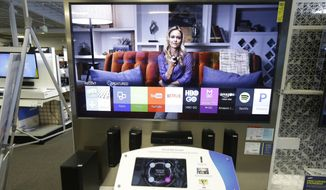 In this file photo taken on Aug. 14, 2015, a Samsung Smart TV is for sale in Sacramento, Calif. Owners of these new smart TV's have been surprised to learn their household conversations could be recorded without their knowledge. (AP Photo/Rich Pedroncelli, File)