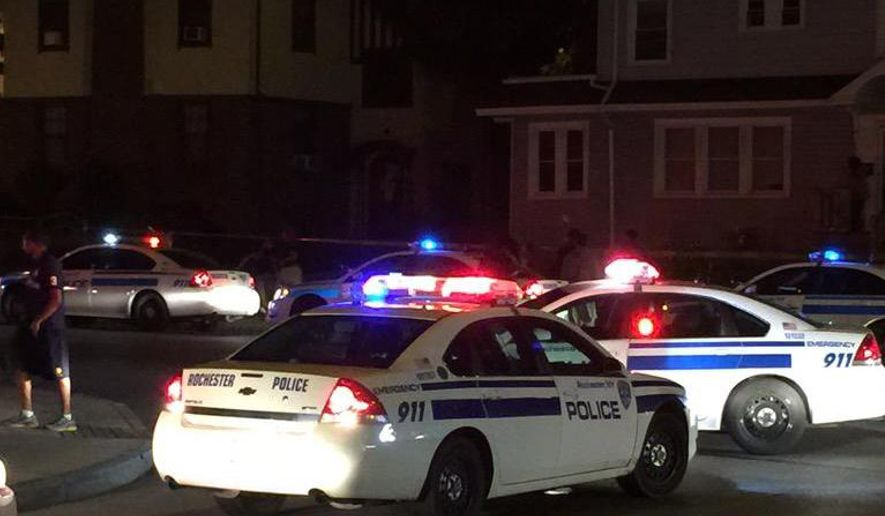 In this photo provided by WHEC-TV, police vehicles block off the street after official said a fatal shooting occurred in Rochester, N.Y., Wednesday, Aug. 19, 2015. Officials have not yet released the names of the victims or the conditions of the several injured. (Jennifer Mobilia/WHEC-TV via AP) MANDATORY CREDIT