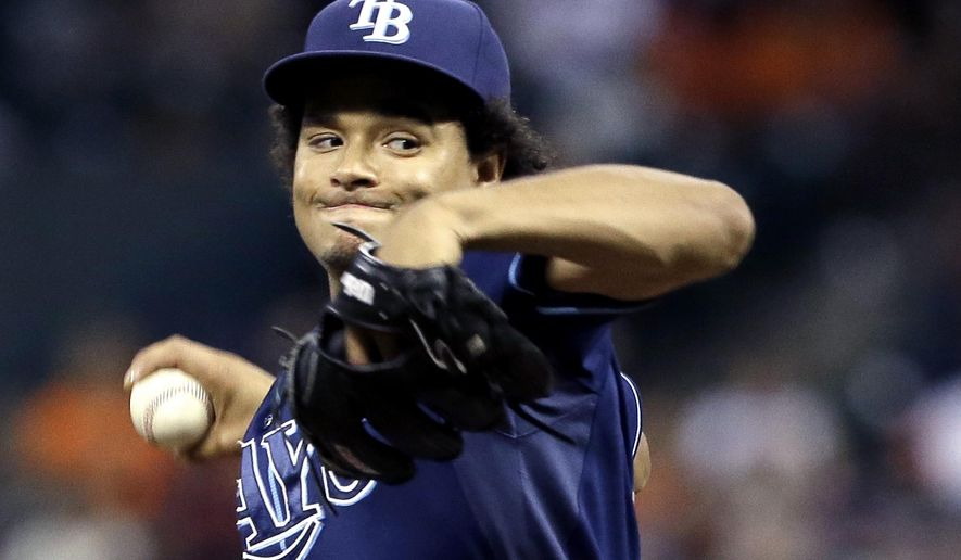Tampa Bay Rays' Chris Archer delivers a pitch against the Houston Astros in the first inning of a baseball game Thursday, Aug. 20, 2015, in Houston. (AP Photo/Pat Sullivan)
