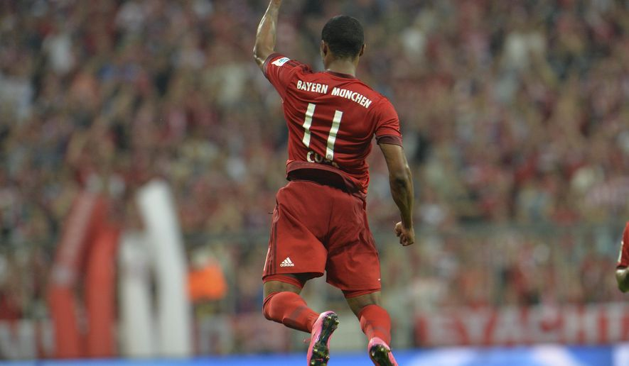 Bayern's Douglas Costa celebrates after scoring his side's fifth goal during the German Bundesliga soccer match between FC Bayern Munich and Hamburger SV in Munich, southern Germany, Friday, Aug. 14, 2015. (AP Photo/Kerstin Joensson)
