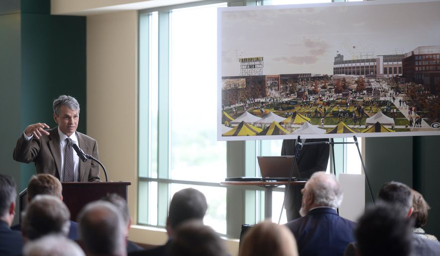 George Kerwin, president and CEo of Bellin Health Care Systems, discusses Bellin's role in the development plans for the new Titletown District in Ashwaubenon, west of Lambeau Field. on Thursday, Aug. 20, 2015, in Green Bay, Wis. The Packers unveiled plans for a four-star hotel, brewery and restaurant, sports medicine facility and a 10-acre public plaza on team property. (Kyle Bursaw/Green Bay Press-Gazette via AP)