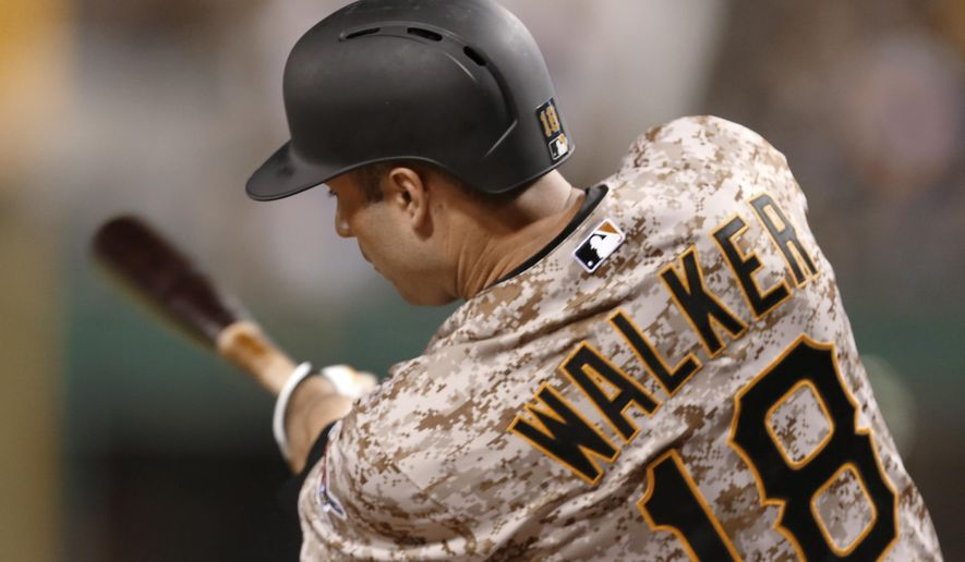 Pittsburgh Pirates' Neil Walker hits a two-run home run against the San Francisco Giants during the sixth inning of a baseball game, Thursday, Aug. 20, 2015, in Pittsburgh. (AP Photo/Keith Srakocic)