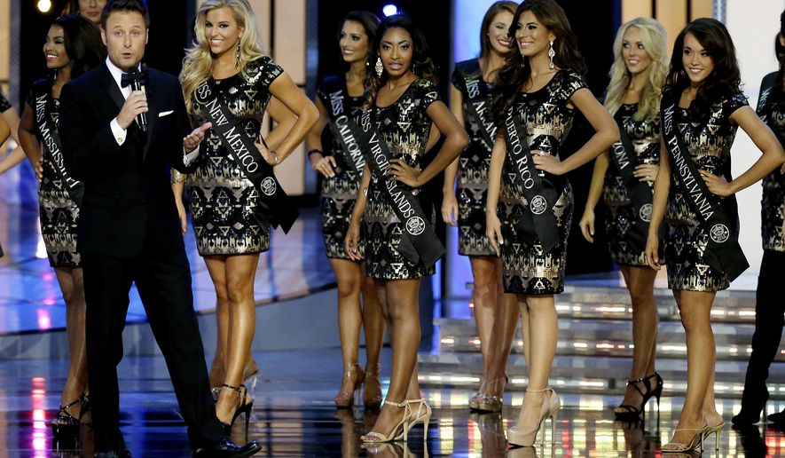 "FILE  In this Sunday, Sept. 14, 2014 file photograph, television personality Chris Harrison, left, talks during the Miss America 2015 pageant, Sunday, Sept. 14, 2014, in Atlantic City, N.J. On Thursday, Aug. 20, 2015, the Miss America Organization announced that Harrison of ABC's ""The Bachelor"" will return to host the Miss America Competition in Atlantic City. This is the seventh time he has handled the duties. (AP Photo/Mel Evans,file)"