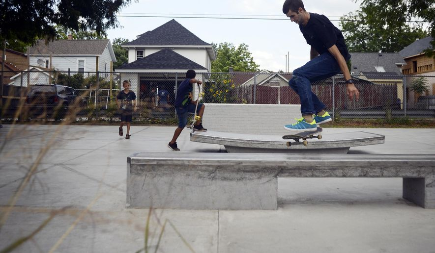 In this photo taken, Wednesday, Aug. 19, 2015, Brian Hoffer, 27, takes advantage of a new skatepark in Westown Commons Park in Grand Rapids, Mich. Grand Rapids voters in 2013 authorized a 7-year property tax that's generating about $4 million annually for parks. The renovation of Westown Commons includes the skate park, a picnic shelter, new landscaping, new sidewalk, benches, bike racks and a drinking fountain.  (Alex McDougall/The Grand Rapids Press via AP) ALL LOCAL TELEVISION OUT; LOCAL TELEVISION INTERNET OUT; MANDATORY CREDIT