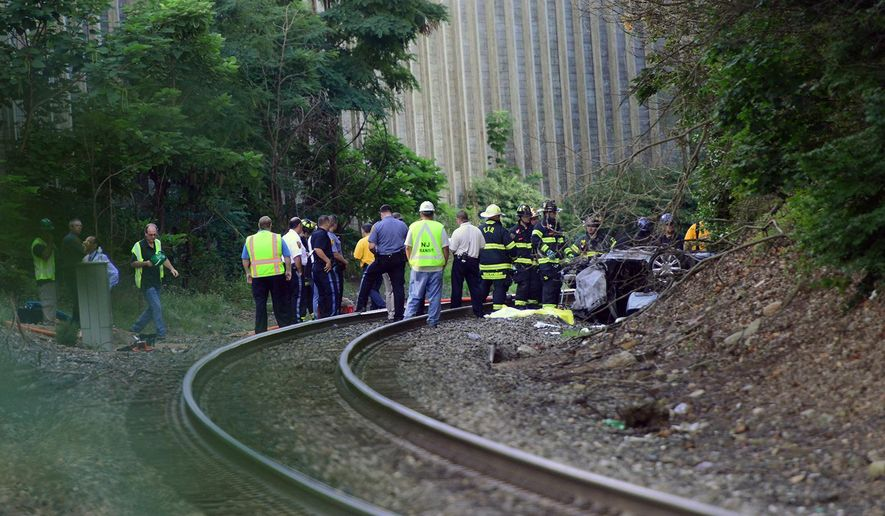 Emergency personnel work the scene of a fatal accident involving a car on the rail road tracks, in Emerson, N.J., Thursday, Aug. 20, 2015. (Tariq Zehawi/The Record of Bergen County via AP) ONLINE OUT; MAGS OUT; TV OUT; INTERNET OUT;  NO ARCHIVING; MANDATORY CREDIT