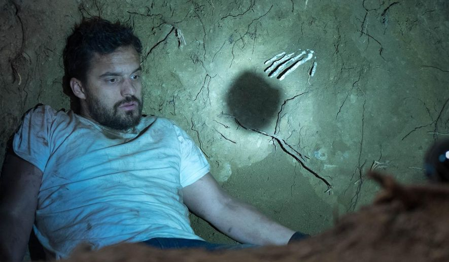 "This photo provided by The Orchard shows Jake Johnson as Tim in a scene from the film, ""Digging for Fire."" The movie releases in U.S. theaters on Friday, Aug. 21, 2015. (Ben Richardson/The Orchard via AP)"