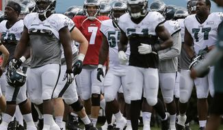 Philadelphia Eagles quarterback Sam Bradford (7) and his teammates move to their next drill during NFL football training camp, Thursday, Aug. 20, 2015, in Philadelphia. (AP Photo/Matt Rourke)