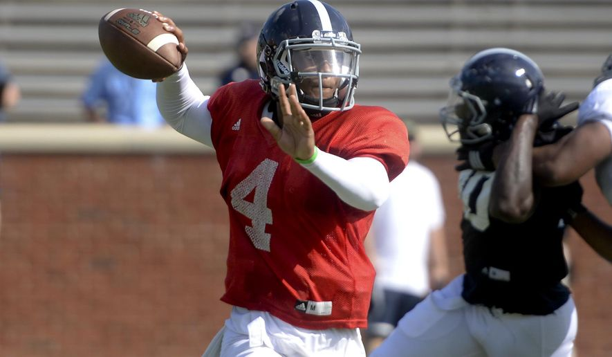 Georgia Southern quarterback Kevin Ellison attempts a pass during a football scrimmage at Paulson Stadium in Statesboro, Ga. on Saturday Aug. 15, 2015.   (Ian Maule/Savannah Morning News via AP) THE EXAMINER.COM OUT; SFEXAMINER.COM OUT; WASHINGTONEXAMINER.COM OUT; MANDATORY CREDIT