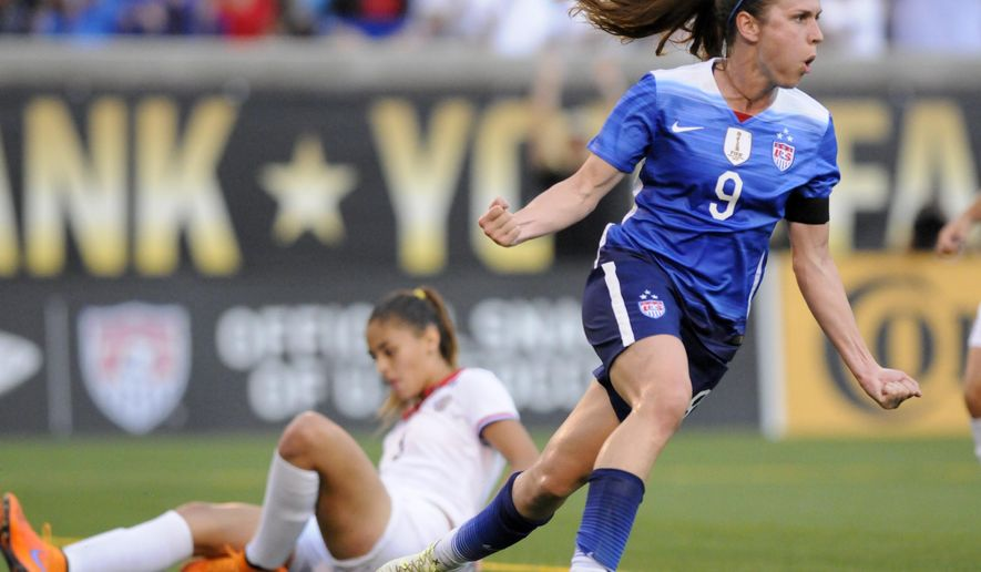 United States' Heather O'Reilley (9) celebrates scoring a goal as Costa Rica defender Fabiola Villalobos sits on the ground during an international friendly soccer match Wednesday, Aug. 19, 2015, in Chattanooga, Tenn. (Doug Strickland/Chattanooga Times Free Press via AP)