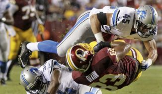 Washington Redskins tight end Chase Dixon (83) is upended by Detroit Lions defensive back Brian Suite (45) during the second half of an NFL preseason football game, Thursday, Aug. 20, 2015, in Landover, Md. (AP Photo/Mark Tenally)