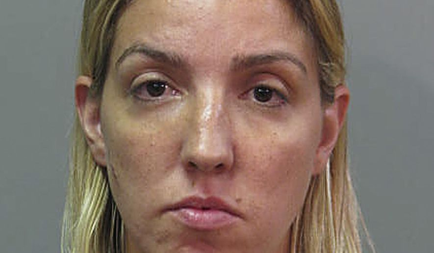 This Wednesday, July 19, 2015 photo provided by the Nassau County Police shows Ann Marie Skelos. She was arrested, Wednesday night, following a dispute at her Long Island home where she allegedly broke the eyeglasses of her 21-year-old nephew, David Hassett, during the scuffle. Skelos is the wife of Adam Skelos, who along with his father, former state Senate leader Dean Skelos, pled not guilty to federal corruption charges. (Nassau County Police via AP)
