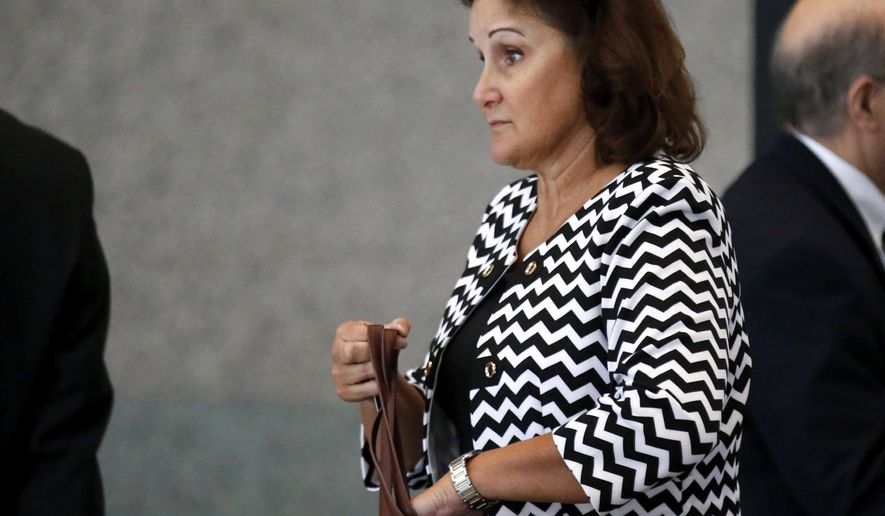 Karen Finley, the former CEO of Arizona-based Reflex Traffic System Inc., arrives for a hearing at the federal building in Chicago, Thursday, Aug. 20, 2015, where she pleaded guilty to using bribery to help her company land lucrative contracts with the city of Chicago. (Jose M. Osorio/Chicago Tribune via AP) MANDATORY CREDIT CHICAGO TRIBUNE; CHICAGO SUN-TIMES OUT; DAILY HERALD OUT; NORTHWEST HERALD OUT; THE HERALD-NEWS OUT; DAILY CHRONICLE OUT; THE TIMES OF NORTHWEST INDIANA OUT; TV OUT; MAGS OUT; NO SALES