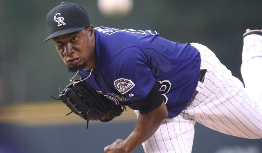 Colorado Rockies relief pitcher Yohan Flande throws to a Washington Nationals batter during the first inning of a baseball game Thursday, Aug. 20, 2015, in Denver. (AP Photo/David Zalubowski)