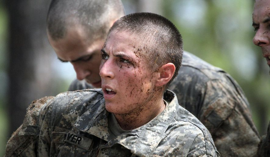 In this April 26, 2015, photo, 1st Lt. Shaye Haver, one of the 20 female soldiers, who is among the 400 students who qualified to start Ranger School, tackles the Darby Queen obstacle course. (Robin Trimarchi/Ledger-Enquirer via AP)