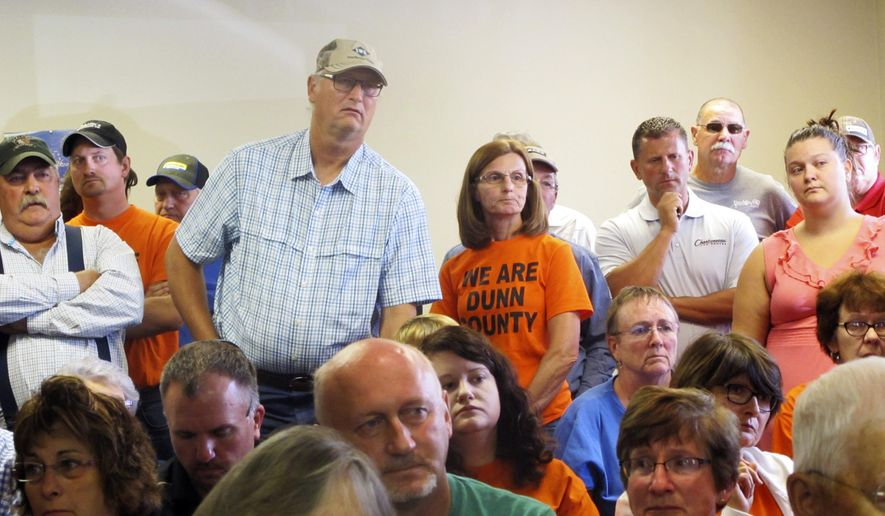 In this Tuesday, Aug. 18, 2015 photo, Mark Kovash stands to make a case for consideration of the citizens when the county makes decisions regarding special landfills for oil and gas waste during a meeting of the Dunn County Commission in Manning, N.D. The commissioners voted against the citizens' proposal. (Lauren Donovan/The Bismarck Tribune via AP)